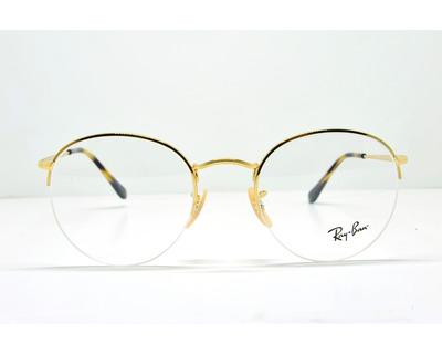 Occhiali da vista Ray Ban colore oro, tondo rb3947v